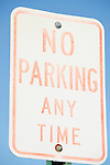 No parking any time faded sign