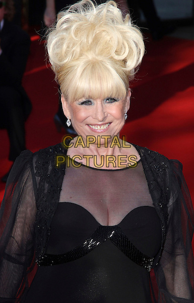 BARBARA WINDSOR .Arrivals at the British Academy Television Awards 2009, Royal Festival Hall, London, England. 26th April 2009..TV Baftas bafta's  half length black sheer see through dress cleavage fringe .CAP/JIL.©Jill Mayhew/Capital Pictures