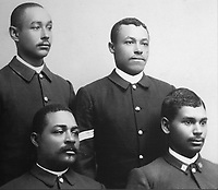 Photograph of African-American enlisted men of the 25th US Infantry, with Sgt M M Harris, Co A (top right), and J T Elliott, Co A (bottom left), exhibited at the Fort Davis National Historic Site, a US army fort established 1854, in a canyon in the Davis Mountains in West Texas, USA. The fort was built to protect emigrants, mail coaches, and freight wagons on the trails through the State from Comanche and Apache Indians. After the Civil War, several African-American regiments were stationed here. By the 1880s, the fort consisted of one 100 buildings, housing over 400 soldiers. It was abandoned in 1891, but many buildings have been restored and the compound now operates as a historical site and museum. Picture by Manuel Cohen
