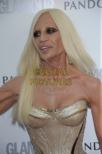 Donatella Versace.Women Of The Year 2012 - Glamour Awards, Berkeley Square, London, England..29th May 2012.half length gold corset strapless cleavage .CAP/PL.©Phil Loftus/Capital Pictures.