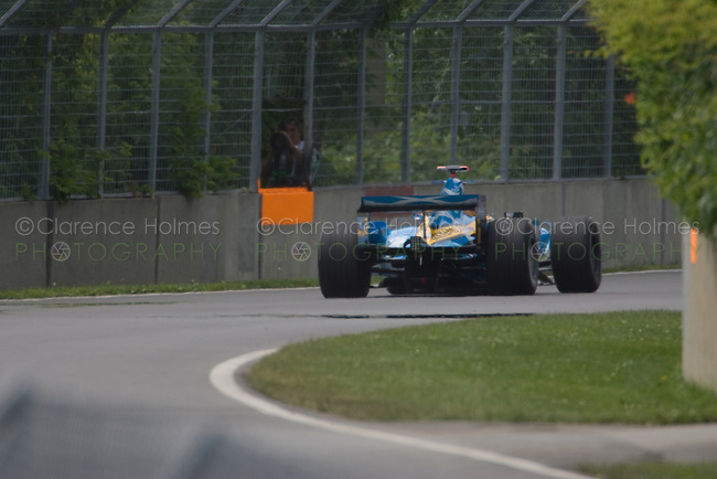 MONTREAL - JUNE 23: Fernano Alonso of Renault F! disappears from view after leaving the Senna complex during the second practice session on the Friday prior to race weekend of the Canadian F1 Grand Prix at the Circuit Gilles-Villeneuve June 23, 2006 in Montreal, Canada.