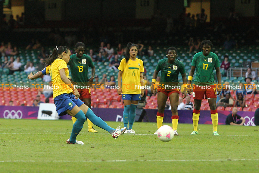 MARTA of Brazil scores the third goal from the penalty spot - Brazil Women vs Cameroon Women - Womens Olympic Football Tournament London 2012 Group E at the Millenium Stadium, Cardiff, Wales - 25/07/12 - MANDATORY CREDIT: Gavin Ellis/SHEKICKS/TGSPHOTO - Self billing applies where appropriate - 0845 094 6026 - contact@tgsphoto.co.uk - NO UNPAID USE.