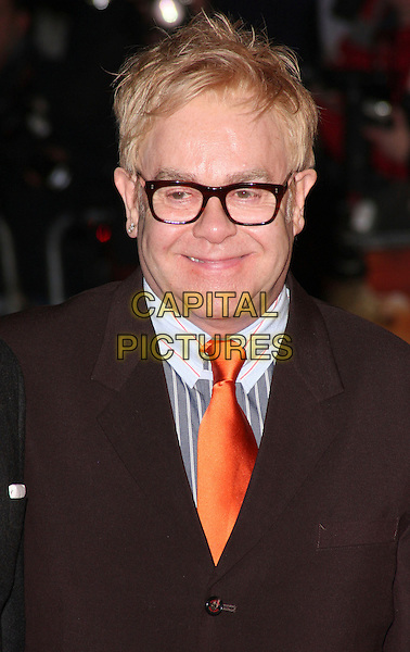 "SIR ELTON JOHN .UK Premiere of ""Australia"" at the Odeon, Leicester Square, London, UK, December 10th 2008..portrait headshot glasses orange tie grey striped gray shirt collar .CAP/ROS.©Steve Ross/Capital Pictures"