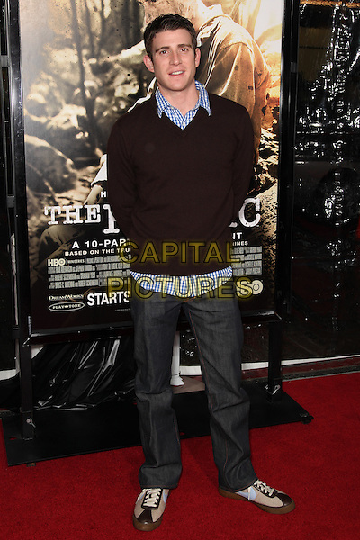BRYAN GREENBERG.Arrivals to the Los Angeles Premiere of the HBO Miniseries The Pacific at Grauman's Chinese Theatre, Hollywood, CA, USA, February 24th, 2010. .Full length jeans blue shirt jumper sweater trainers check checked black gingham shirt .CAP/CEL.©CelPh/Capital Pictures.