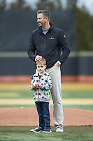 Kyle Sleeth, 2019 Wake Forest Sports Hall of Fame inductee, stands behind his son Avery as he prepares to throw out a ceremonial first pitch prior to the NCAA baseball game between the Illinois Fighting Illini and the Wake Forest Demon Deacons at David F. Couch Ballpark on February 16, 2019 in  Winston-Salem, North Carolina.  The Fighting Illini defeated the Demon Deacons 5-2. (Brian Westerholt/Four Seam Images)