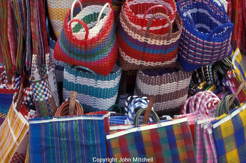 Brightly coloured plastic and nylon shopping bags for sale in the Mercado dan Juan de Dios, Guadalajara, Mexico