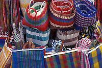 Brightly coloured plastic and nylon shopping bags for sale in the Mercado dan Juan de Dios, Guadalajara, Mexico