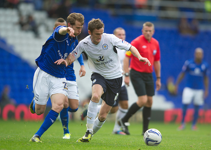 Leicester City's Andy King shields the ball from Birmingham City's Jonathan Spector ..Football - npower Football League Championship - Birmingham City v Leicester City - Saturday 20th October 2012 - St Andrews - Birmingham..