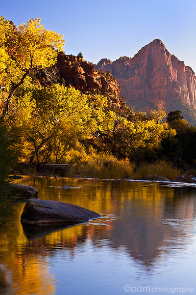 The Watchman, and its reflection, in Zion captured during the last rays of the day.