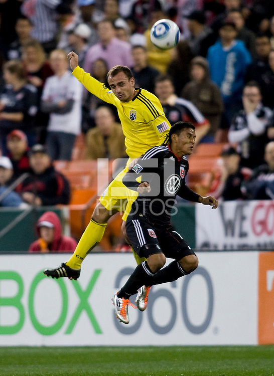 Andy Najar (14) of D.C. United goes up for a header with Rich Balchan (2) of the Columbus Crew during the home opener at RFK Stadium in Washington D.C.  D.C. United defeated the Columbus Crew, 3-1.