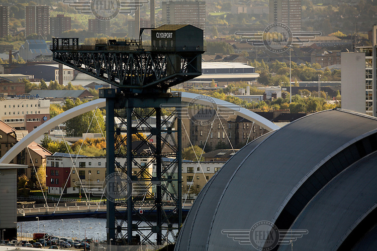 The old Finnieston Titan crane in Glasgow which once lifted trains onto ships to travel down the River Clyde and thence across the British empire. In the foreground is the Clyde Auditorium, popularly known as the Armadillo.