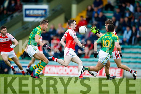 John Curran South Kerry in action against Tom O'Sullivan Dingle in the Quarter Final of the Kerry Senior County Championship at Austin Stack Park on Sunday.