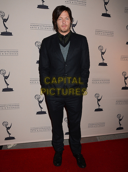 """Norman Reedus.The Academy of Television Arts & Sciences hosts an evening with """"The Walking Dead"""", North Hollywood, California, USA..February 5th, 2013.full length black suit green jumper top hands in pockets stubble facial hair .CAP/ADM/BT.©Birdie Thompson/AdMedia/Capital Pictures."""