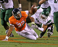 Oct 23, 2010; Charlottesville, VA, USA;  Virginia Cavaliers running back Keith Payne (22) fumbles the ball in front of Eastern Michigan Eagles cornerback Marty Cardwell (6) during the 1st half of the game at Scott Stadium.  Eastern Michigan Eagles recovered the ball. Mandatory Credit: Andrew Shurtleff