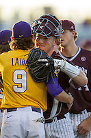Texas A&M Aggies catcher Michael Barash (5) hugs LSU outfielder Mark Laird (9) following their Southeastern Conference baseball game on April 25, 2015 at Alex Box Stadium in Baton Rouge, Louisiana. Texas A&M defeated LSU 6-2. (Andrew Woolley/Four Seam Images)