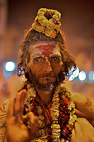 A Sadu during the Aarti Ceremony on the Ganges River Varanasi India,
