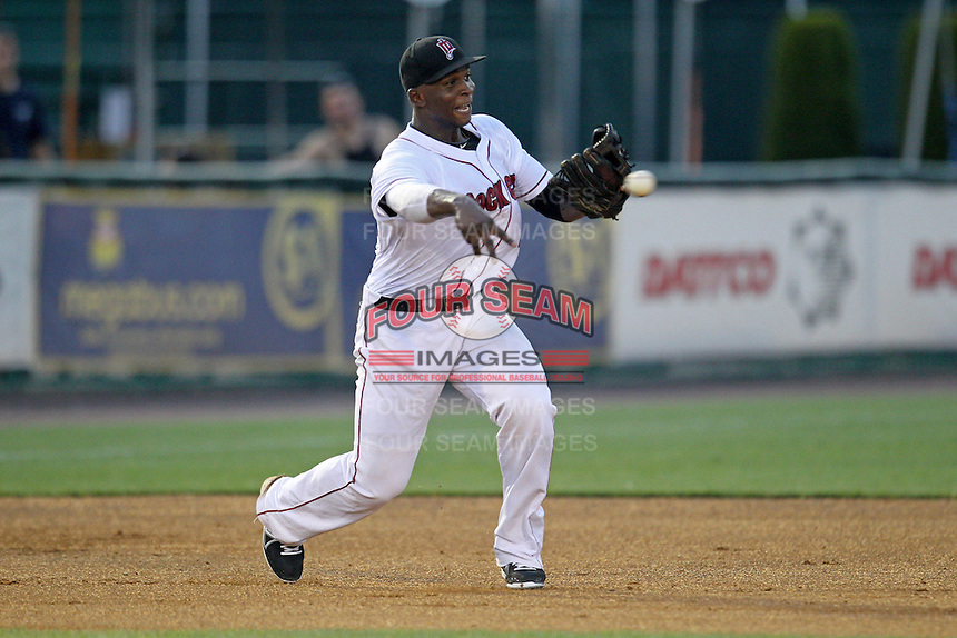 New Britain Rock Cats third baseman Miguel Sano #24 throws during a game against the Binghamton Mets at New Britain Stadium on July 18, 2013 in New Britain, Connecticut. (Brace Hemmelgarn/Four Seam Images)