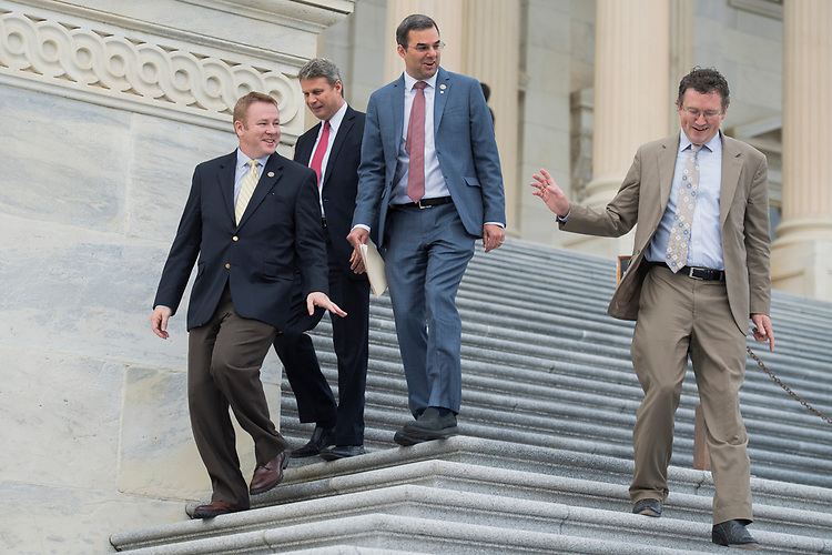 UNITED STATES - OCTOBER 26: From left, Reps. Warren Davidson, R-Ohio, Bill Huizenga, R-Mich., Justin Amash, R-Mich., and Thomas Massie, R-Ky., leave the Capitol after the House passed a fiscal 2018 budget resolution on October 26, 2017. (Photo By Tom Williams/CQ Roll Call)