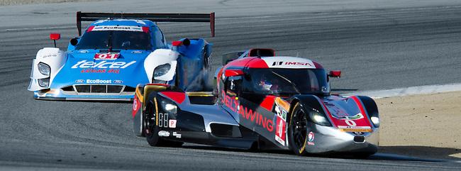 Monterey California, May 4, 2014, Laguna Seca Monterey Grand Prix, the DeltaWing Racing Cars prototype leads the Ganassi Racing Riley DP.