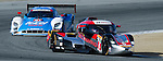 Monterey California, May 4, 2014, Laguna Seca Monterey Grand Prix, the DeltaWing Racing Cars prototype leads the Ganassi Racing Riley DP.