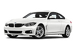 Stock pictures of low aggressive front three quarter view of a 2019 BMW 4 series M Sport 2 Door Coupe