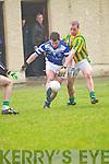 Annascaul Aiden Crean tackled by Lios Poil Pól Ó Eibhín during the West Kerry Championship match at Dingle GAA Grounds on Sunday afternoon..