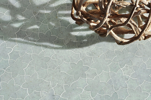 Cadiz, a waterjet mosaic shown in polished Ming Green, is part of the Miraflores collection by Paul Schatz for New Ravenna.<br />