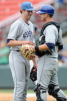 Pitcher Trent Blank (22) of the Asheville Tourists and catcher Ashley Graeter (6) congratulate each other after a game against the Greenville Drive on Sunday, July 20, 2014, at Fluor Field at the West End in Greenville, South Carolina. Asheville won game two of a doubleheader, 3-2. (Tom Priddy/Four Seam Images)