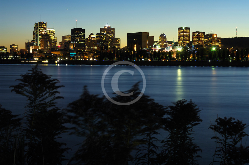 Canada, Montreal, Montreal city skyline at night across Saint Lawrence River