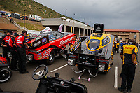 Jul 21, 2017; Morrison, CO, USA; The cars of NHRA funny car driver Cruz Pedregon (left) alongside J.R. Todd during qualifying for the Mile High Nationals at Bandimere Speedway. Mandatory Credit: Mark J. Rebilas-USA TODAY Sports