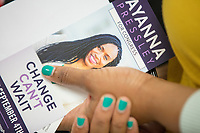 A woman holds a campaign flyer for candidate Ayanna Pressley after Pressley spoke at an event put on by Chelsea Black Community at the Chelsea Senior Center in Chelsea, Massachusetts, USA, on Wed., June 27, 2018. Pressley is running in the Democratic primary Massachusetts 7th Congressional District against incumbent Mike Capuano. Pressley is currently serving as a member of the Boston City Council, and is the first woman of color elected to the Council.