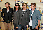 UNIVERSAL CITY, CA. - May 31: Musicians Kings of Leon arrive at the 2009 MTV Movie Awards held at the Gibson Amphitheatre on May 31, 2009 in Universal City, California.