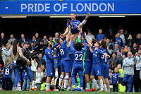 Chelsea's Gary Cahill is lifted into the air by his Chelsea teammates on the pitch at the final whistle during Chelsea vs Watford, Premier League Football at Stamford Bridge on 5th May 2019