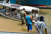 Fazenda Sayonara, Mato Grosso State, Brazil. Preparing the boat; Patrick Cunningham, Aparecido, Ari, Malaco.