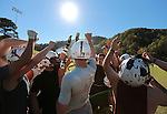 The Leslie County football team raises their hands in a huddle at the end of practice at Leslie County High School in Hyden, Ky. on Thursday, October 10, 2013. Photo by Adam Pennavaria