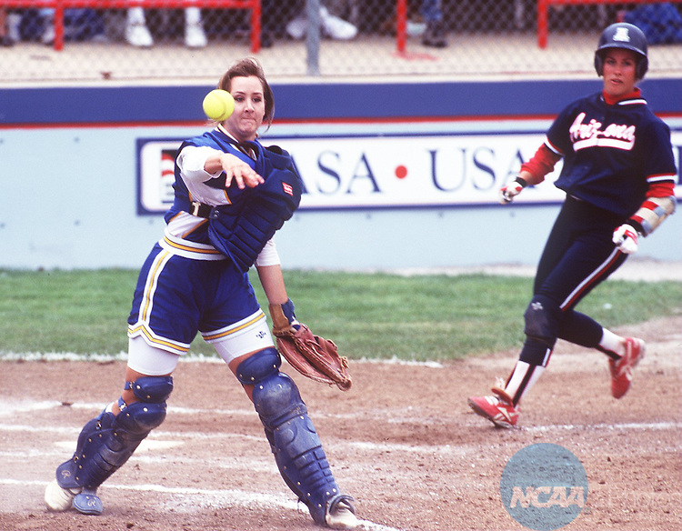 Caption: UCLA catcher Cindy Valero throws out a Arizona batter at first base during the Division I Womenâ Softball Championships May 29, 1995 in Oklahoma City, Oklahoma. UCLA went on to defeat the Arizona Wildcats 4-2 and capture the National Championship. Lisa Rudy Hoke/NCAA photos.