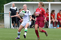 20180815 - Zulte , BELGIUM : pictured in a duel with Zulte's Amber Bert (r) during a friendly pre season soccer match between the women teams of Zulte Waregem Dames and OHL Oud Heverlee Leuven Dames  , Wednesday 15 August 2018 . PHOTO DAVID CATRY | SPORTPIX.BE