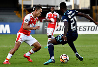 BOGOTA - COLOMBIA - 01 - 03 - 2018: Anderson Plata (Izq.) jugador de Independiente Santa Fe disputa el balón con Ronald Johnson (Der.) jugador de Emelec (ECU), durante partido entre Independiente Santa Fe (COL) y Emelec (ECU), de la fase de grupos, grupo 4, fecha 1 de la Copa Conmebol Libertadores 2018, jugado en el estadio Nemesio Camacho El Campin de la ciudad de Bogota. / Anderson Plata (L) player of Independiente Santa Fe vies for the ball with Ronald Johnson (R) player of Emelec (ECU), during a match between Independiente Santa Fe (COL) and Emelec (ECU), of the group stage, group 4, 1st date for the Conmebol Copa Libertadores 2018 at the Nemesio Camacho El Campin Stadium in Bogota city. Photo: VizzorImage  / Luis Ramirez / Staff.