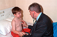 A G.P. doctor on a house call treating a young child. The doctor is using a stethoscope to listen to the childs heart and lungs...© SHOUT. THIS PICTURE MUST ONLY BE USED TO ILLUSTRATE THE EMERGENCY SERVICES IN A POSITIVE MANNER. CONTACT JOHN CALLAN. Exact date unknown.john@shoutpictures.com.www.shoutpictures.com...
