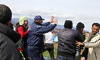 Pictured: A policeman gets involved to try and break off a fight between migrants Tuesday 08 March 2016<br /> Re: Heavy overnight rain has flooded the migrant camp at the Greek FYRO Macedonian border of Idomeni in Greece