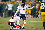 Chicago Bears punter Adam Podlesh (8) holds the ball for kicker Robbie Gould (9) during a week 16 NFL football game against the Green Bay Packers on December 25, 2011 in Green Bay, Wisconsin. The Packers won 35-21. (AP Photo/David Stluka)