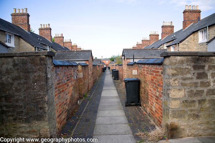 Back alley with rubbish bins. The Railway Village built by GWR to house workers in the 1840s, Swindon, England