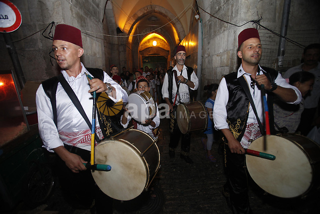 A religious eulogy band perform during islamic celebration during a celebrate the holy month of Ramadan in Herod's Gate north of the old city of Jerusalem, on July 29, 2013. Muslims around the world are observing the holy fasting month of Ramadan in which they refrain from eating, drinking, sex and smoking from dawn to dusk. Photo by Saeed Qaq