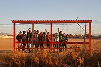 Niños en banca o dogout de campo de deportivo de trerraceria. Jóvenes de la calle al atardecer. Niños de Hermosillo y Adolescentes. <br /> <br /> Foto: Denise Robles<br /> <br /> Keywords: Delicuentes, vagancia, no papas, vagos, delinquir, sin supervision, drogas.