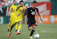 WASHINGTON, DC - AUGUST 4, 2012:  Chris Pontius (13) of DC United moves away from Justin Meram (9) of the Columbus Crew during an MLS match at RFK Stadium in Washington DC on August 4. United won 1-0.