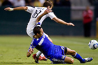 LA Galaxy forward Mike Magee and Kansas City Wizard midfielder Davy Arnaud battle. The Kansas City Wizards beat the LA Galaxy 2-0 at Home Depot Center stadium in Carson, California on Saturday August 28, 2010.