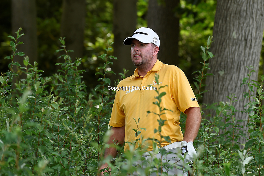 August 6, 2016: Robert Garrigus looks for his ball in the shrubs off the cart path on the 15th hole during day three of the PGA Travelers Championship held at TPC River Highlands in Cromwell CT. Eric Canha/CSM