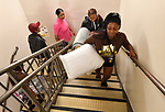 Britney Christian leads the way up the stairs at the Gillespie Residence Hall on the campus of Harris-Stowe State University in St. Louis on Wednesday August 15, 2018. She was helping move in new student Kai Lloyd from Chicago (behind Christian) who was accompanied by other members of her family.<br />  Photo by Tim Vizer