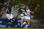 10 November 2012: Duke's Mollie Pathman (24) plays the ball past Loyola Maryland's Jenny Thornton (28) and Kelsey Rene (5). The Duke University Blue Devils played the Loyola University Maryland Greyhounds at Koskinen Stadium in Durham, North Carolina in a 2012 NCAA Division I Women's Soccer Tournament First Round game. Duke won the game 6-0.
