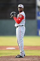 Lowell Spinners pitcher Mario Alcantara (99) gets ready to deliver a pitch during a game against the Batavia Muckdogs on July 18, 2014 at Dwyer Stadium in Batavia, New York.  Lowell defeated Batavia 11-2.  (Mike Janes/Four Seam Images)